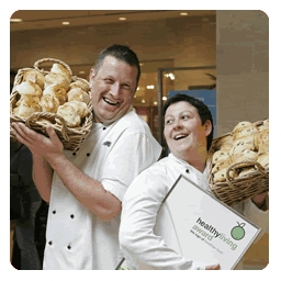 photograph of caterers holding bread rolls